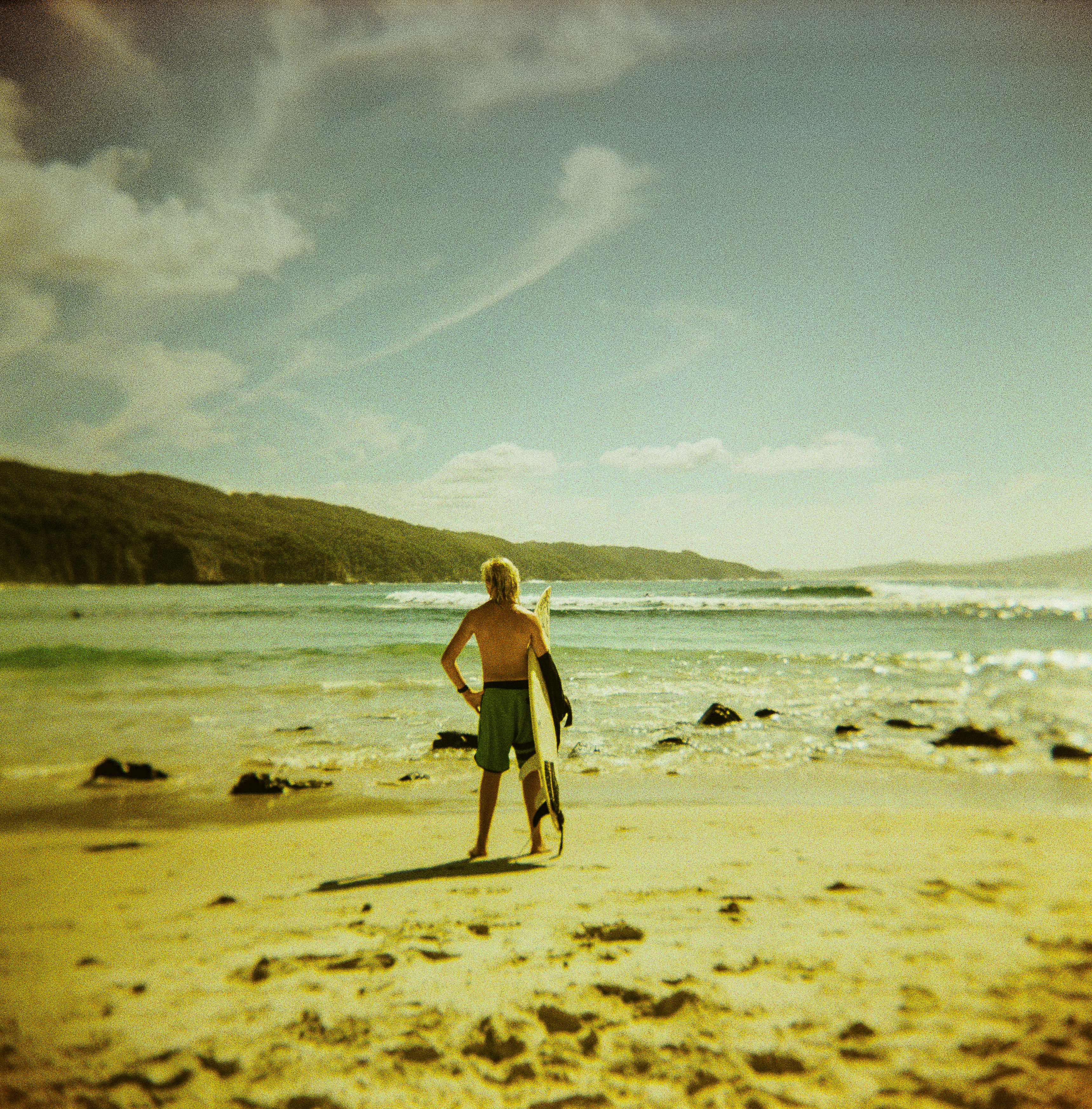 Surfer contemplates the waves at Number One Beach, Seal Rocks. Shot on the Holga