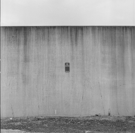 A bit of a metaphor I suppose- the wall, sign and monochromeness